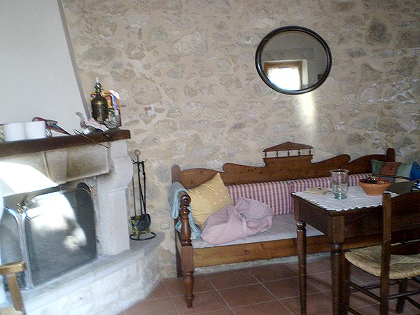 Crete. Guest house Agioklima. Livingroom with a fireplace