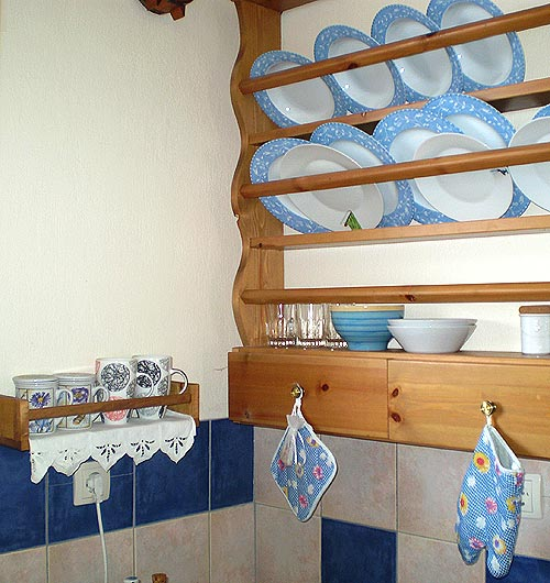 old style shelves for the dishes and cups