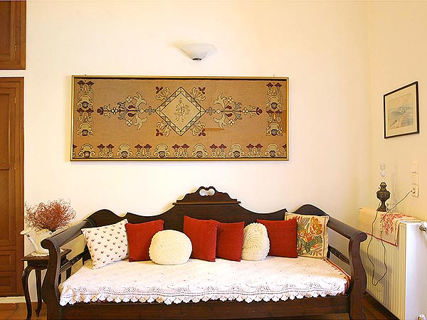 Bedroom. Traditional house. View to vines and olive trees